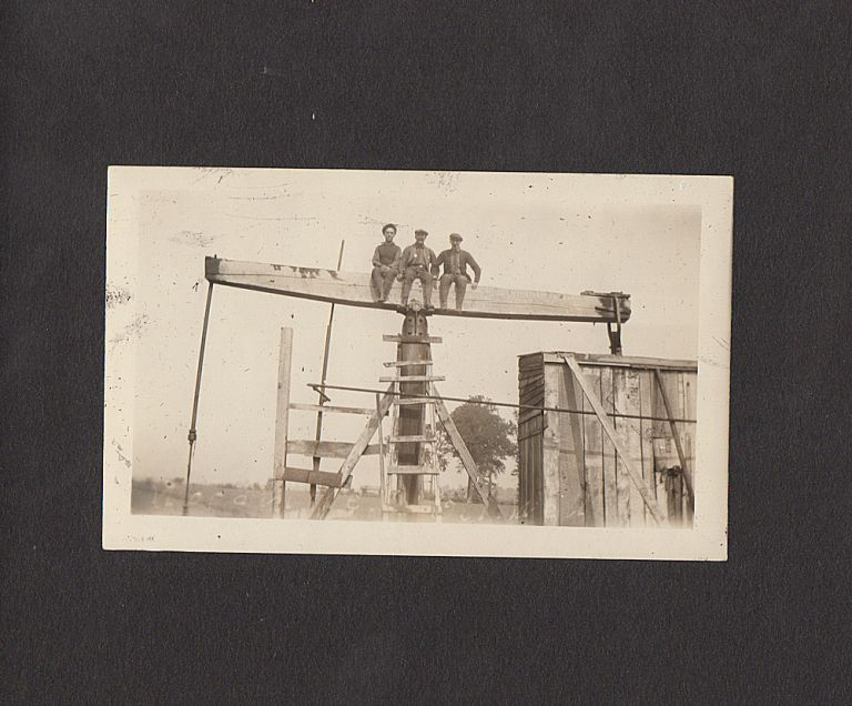 Photograph album documenting two itinerant roughnecks' travel through New York, Pennsylvania, and Ohio until they found jobs at the Woodville Oil Field. Unidentified compiler.