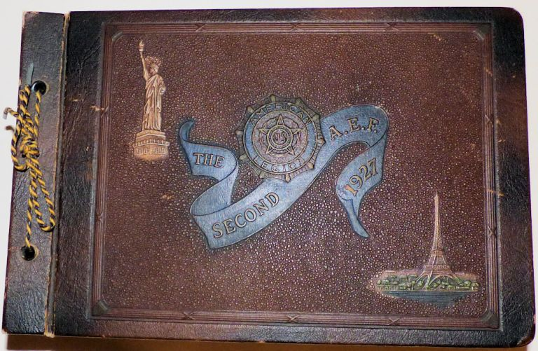 """Memory book kept by a World War One veteran documenting """"The Second A. E. F. 1927,"""" the American Legion's ninth annual convention held in Paris, France. James A. Watson."""