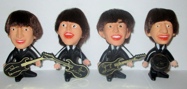 """SHE LOVES YOU, YEAH, YEAH, YEAH."" - Complete set of Beatlemania Moptop figurines released shortly after their blockbuster American debut on the Ed Sullivan Show on February 9th, 1964"