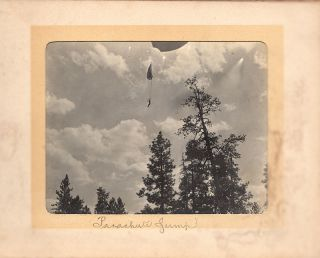 Photograph album with what is probably the earliest photographs of a parachute descent.
