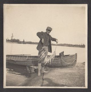 Photograph album documenting a hunting and fishing trip to Georgian Bay led by Native American guides.