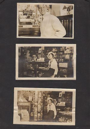 Photograph album including 20 images of a drug store. Unknown compiler