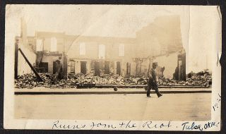Photograph album compiled by an African American railroad steward including one image of the aftermath of the Tulsa Race Riot. Herbert Hardy.