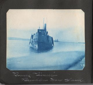 Small album with nine cyanotypes (and two photographs) of Brooklyn and outstate New York