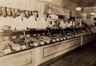 Occupational cabinet card photograph of a 1920s-1930s butcher shop. Photographer unknown.