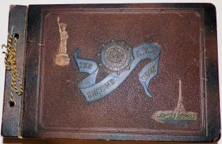 "Memory book kept by a World War One veteran documenting ""The Second A. E. F. 1927,"" the American Legion's ninth annual convention held in Paris, France. James A. Watson."